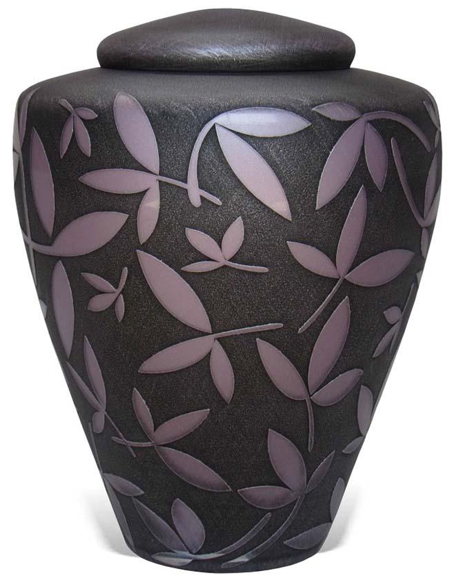 https://grafdecoratie.nl/photos/Uver3-glazen-Manzini-urn-matzwart-roze-sierbladeren.jpg