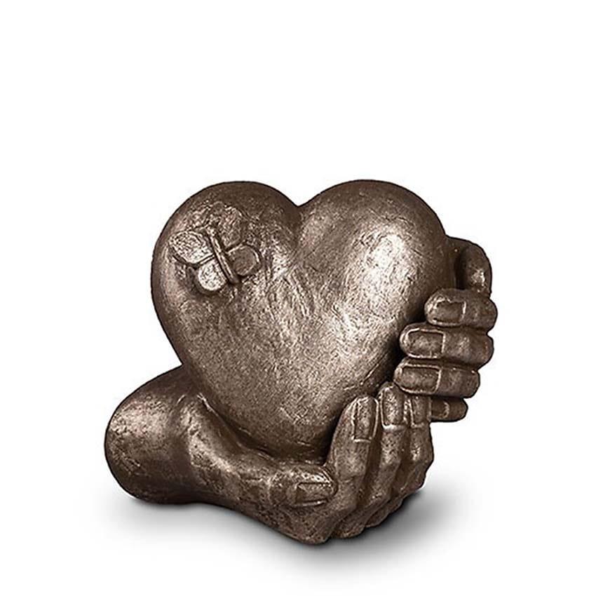 https://grafdecoratie.nl/photos/design-urn-Hartepijn-keramiek-zilver-keramische-art-urnen-UGKS065.JPG