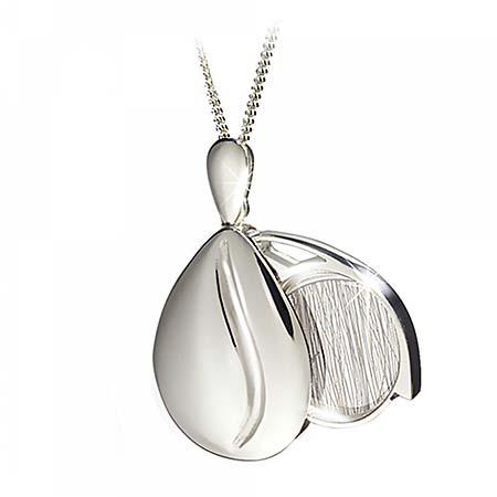 https://grafdecoratie.nl/photos/haarlokhanger-zilver-medaillon-gedenksieraden-TW2008-2.JPG