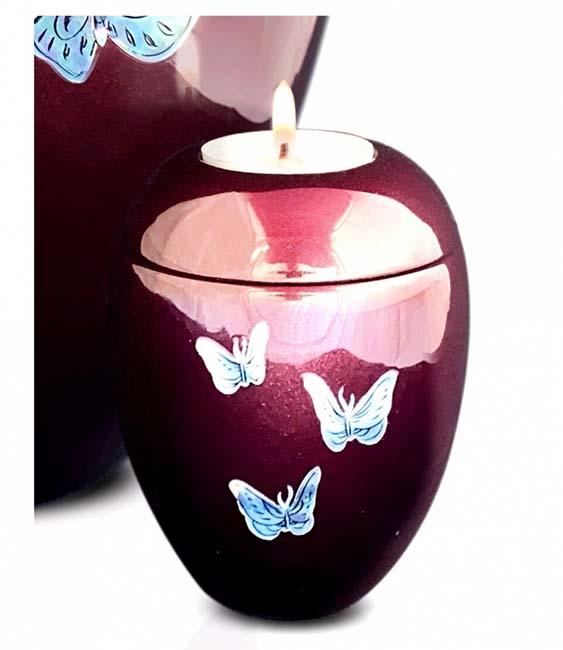https://grafdecoratie.nl/photos/kaarshouder-urn-bordeaux-vlinders-urnwebshop-UU420026B.jpg